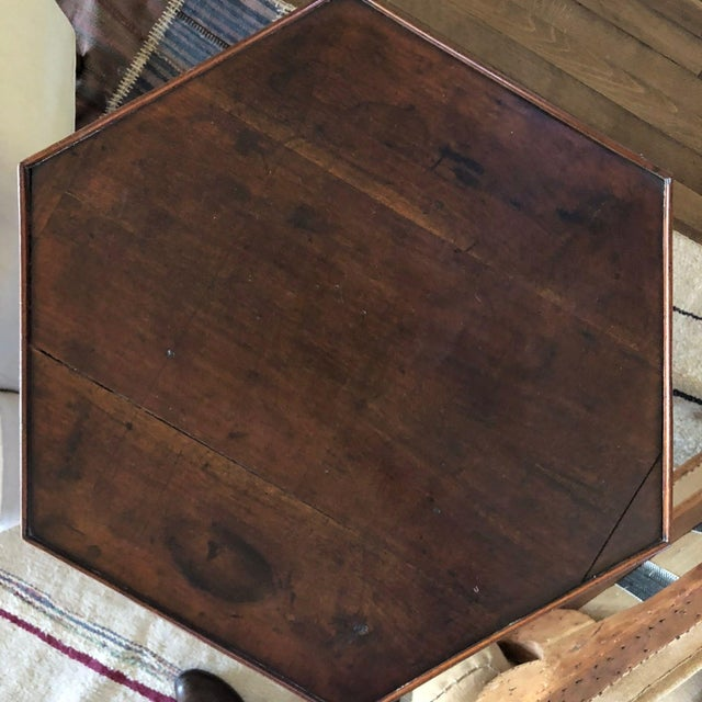 An octagonal side table dating from 18th century England.