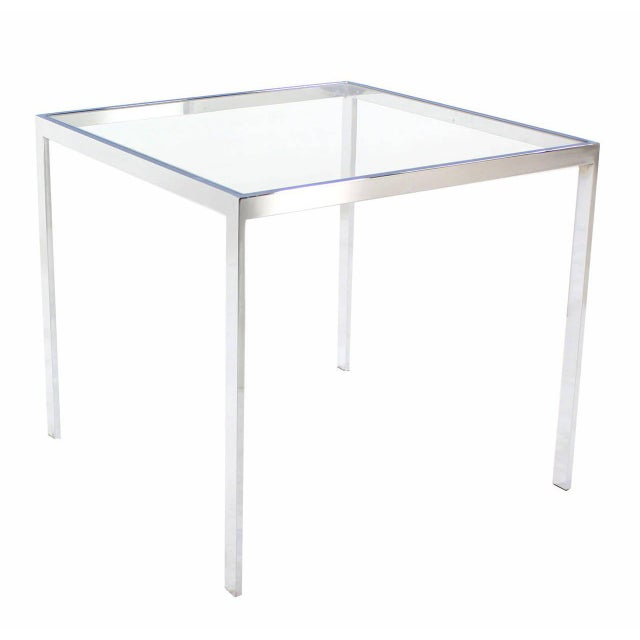 Mid-century modern square chrome and glass occasional side table.