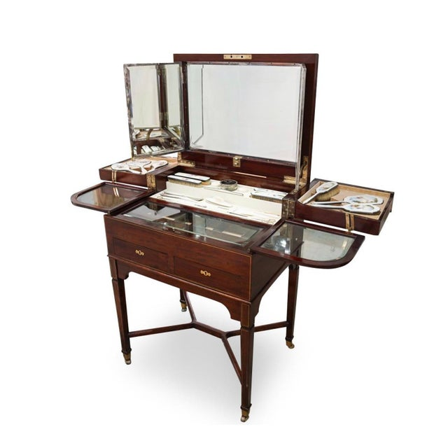 George Betjeman & Sons Edwardian Mahogany Enclosed Dressing Table. Constructed in a finely grained mahogany, with line...