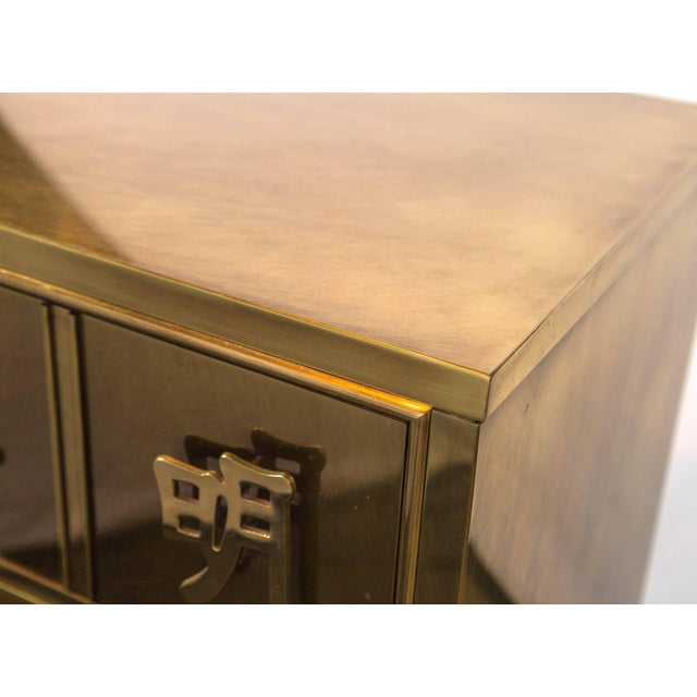 Stunning Mastercraft brass three-drawer chest with solid brass Chinese characters as drawer pulls and decoration. One of...