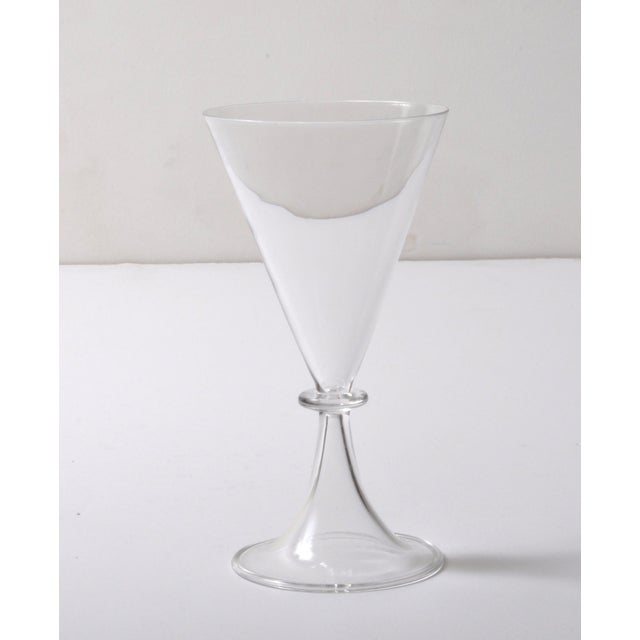 Gorgeous set of eight Champagne goblets of unknown make and date. The fine crystal design brings to mind French and...