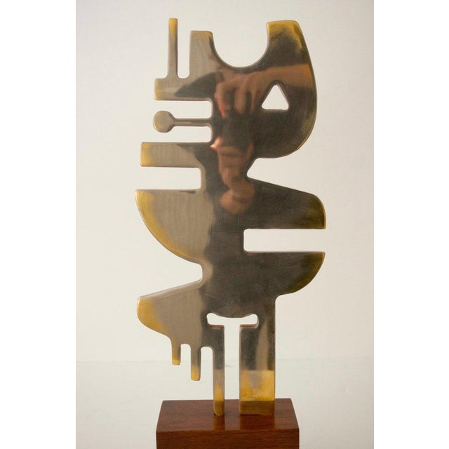 This stylish and avant-garde plated steel sculpture was acquired from a private collector in Palm Beach and is titled...
