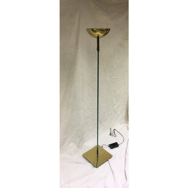 """A Mid-century Italian brass and glass """"Laser"""" floor lamp by Max Baguara, for Lamperti, Italy. A glass column supported by..."""