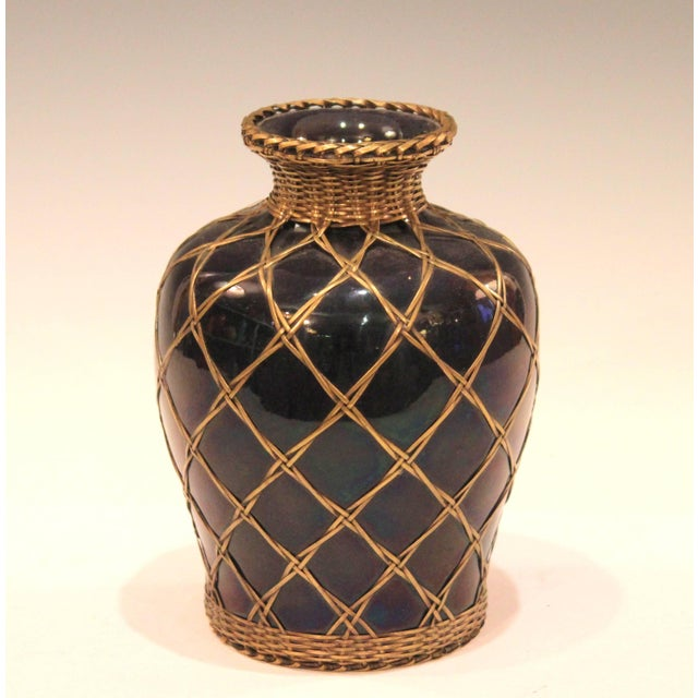 Antique Awaji pottery vase from the Sumoto kiln of Tamura Kyuhei, circa 1910. With tightly wound bronze weaving over a...