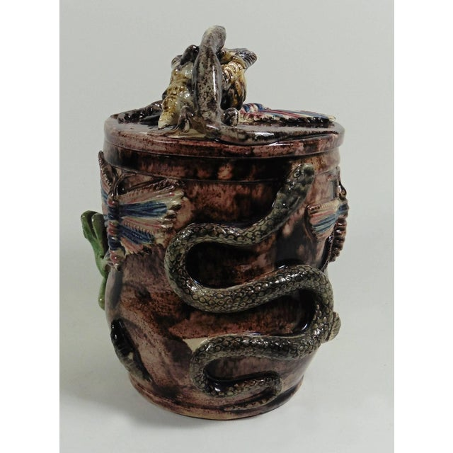 This is a large Portuguese Palissy tobacco jar attributed to Manuel Mafra. This tobacco jar is decorated in high relief of...