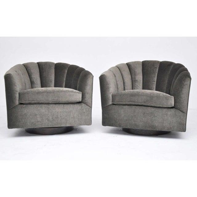 Mid-Century swivel chairs. Fully restored dark walnut bases. Newly upholstered.
