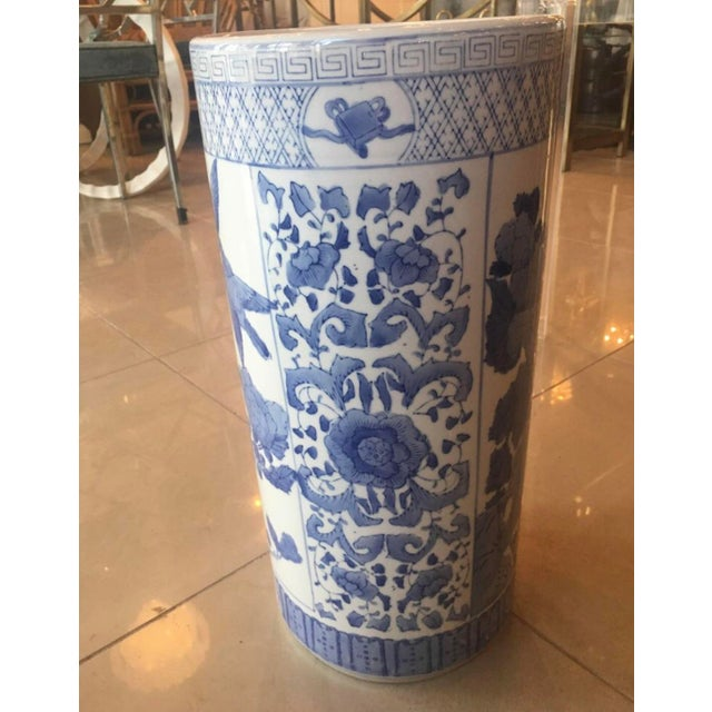 Beautiful vintage blue and white umbrella stand, made in China. No chips or breaks. Floral, bird and Greek key motif.