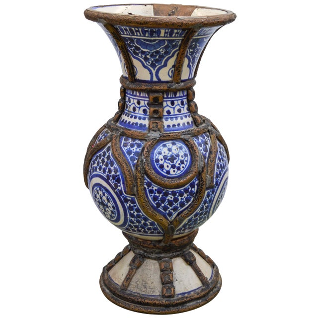 Handcrafted ceramic vase from Fez, Morocco. Exhibiting an ornate hand-painted Moorish pattern in blue and white with...