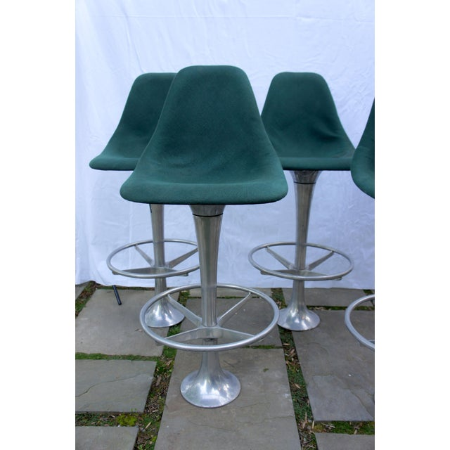 A rare set of 5 floor-anchored bar stools, attributed to Ray & Charles Eames for Herman Miller. Unique and groovy vibes....