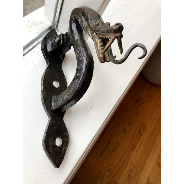 A beautiful and unique example of craftsmanship and artistic design. Serpent/dragon door knocker - solid, heavy and one-...