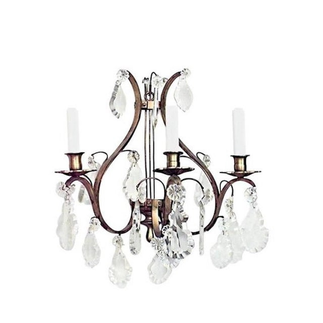 Four pairs of French Louis XV style (20th century) bronze and crystal lyre design three-arm wall sconces (priced per pair).