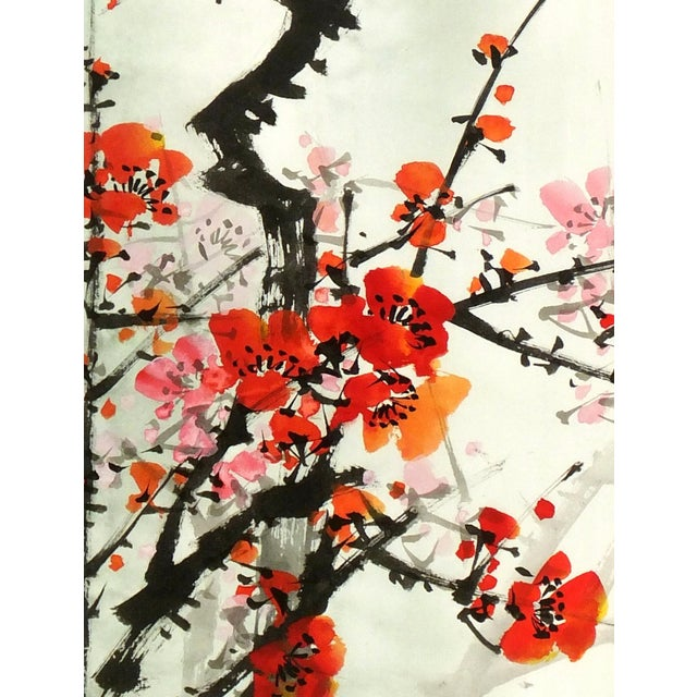 Hand-pulled Chinese silk serigraph of spring plum blossoms with title and seal upper right. Displayed on a white mat with...