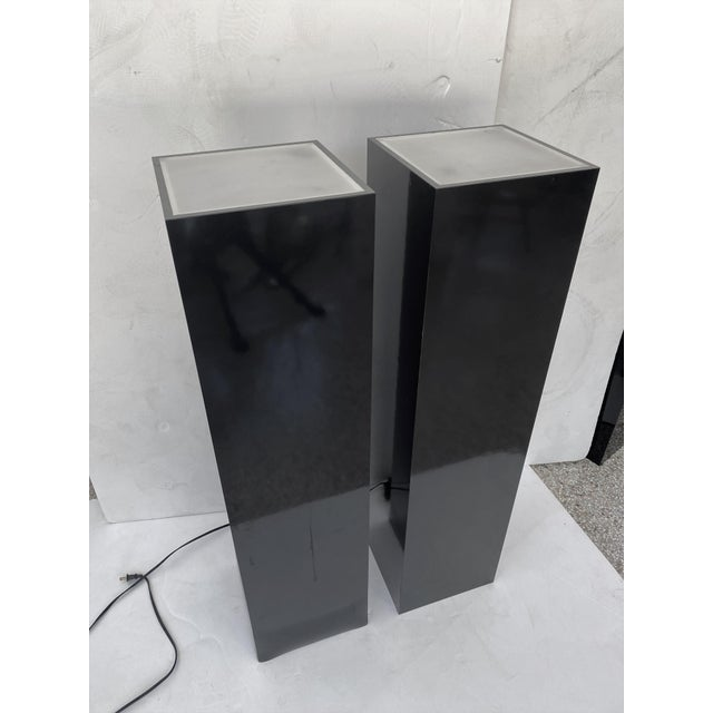 This stylish pair of cleanlined illuminated black laminate and frosted lucite pedestals will help to showcase your...