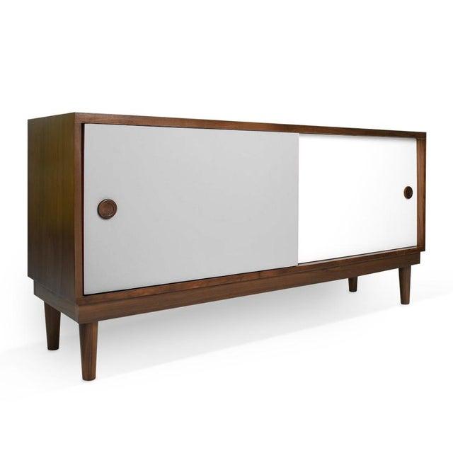 Lukka Modern Kids Walnut Wood Credenza Console. A simple elegant design, a modern take on a '50s inspired shape. Our Lukka...