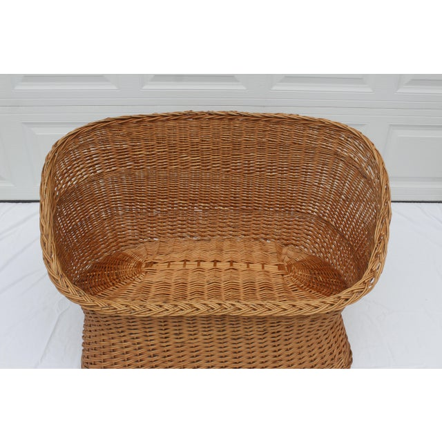 Vintage rattan loveseat/settee. This Boho Chic style looks great with layered new and vintage textiles.