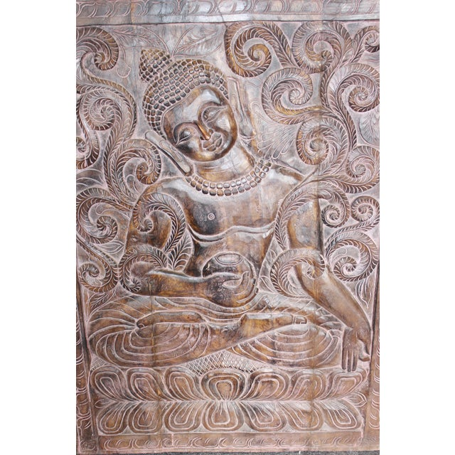 Beautiful vertical hand carved buddha wall panel can either be hung on the wall or use as a door panel. The hand carved...