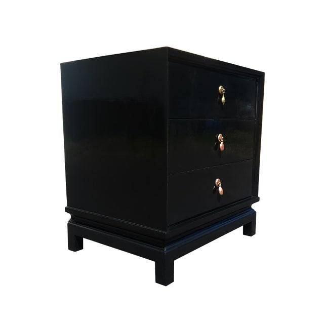 """A black lacquered nightstand / dresser Made by American of Martinsville Circa 1970 Brass handles Dimensions: 22""""W x 17""""D x..."""