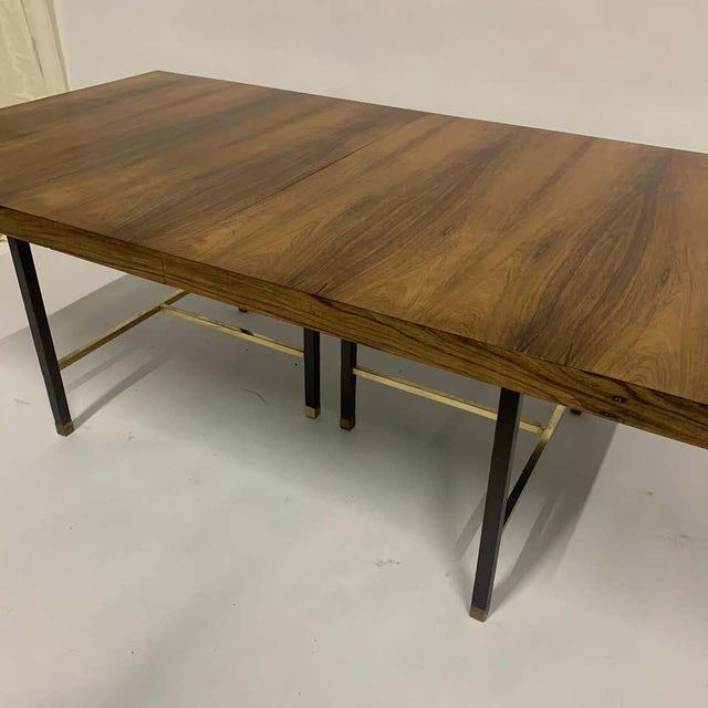 Stunning all original Harvey Probber dining table in Brazilian rosewood with brass stretchers and feet, and mahogany base/...