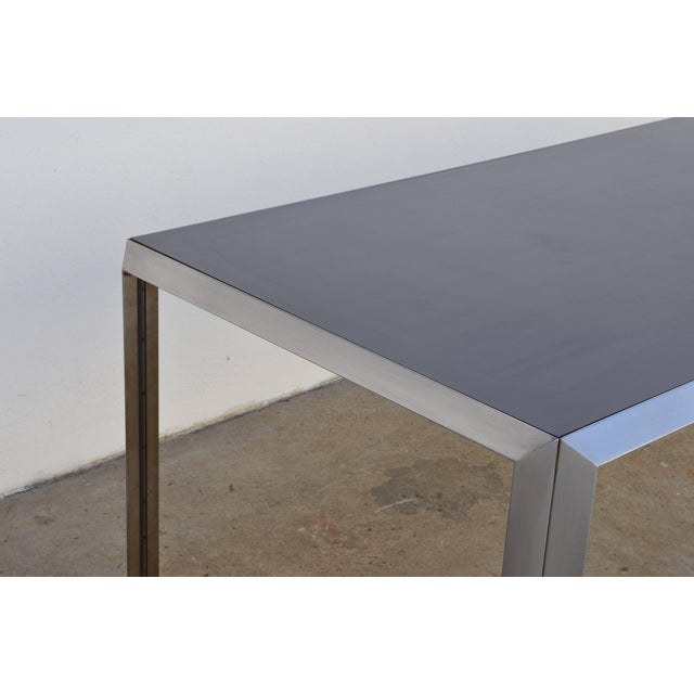 Rare brushed stainless steel and laminate desk by Bernard Marange for TFM. The laminate top is a marine/dark shade of...