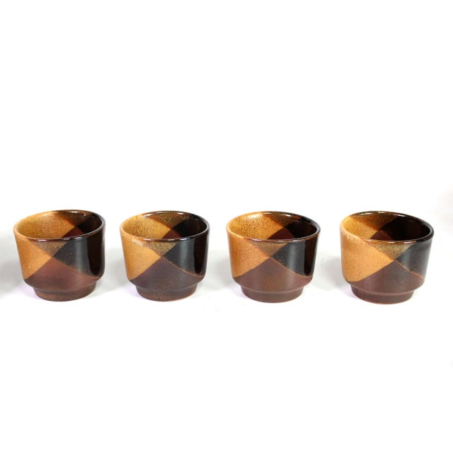 This gorgeous complete set of organic modern quadri-tone wine set by David Cressey for Pottery Craft USA is made of thick...