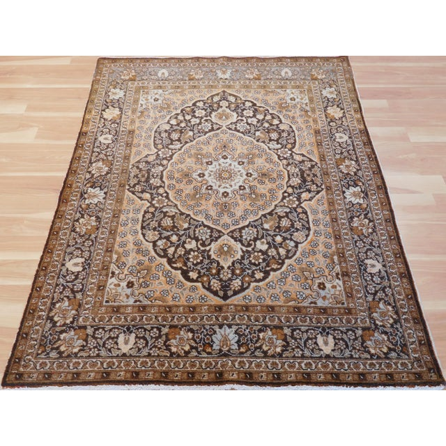 """this is a lovely vintage Tabriz rug in size 4 x 5'4"""" Tabriz is one of the magic names in Persian Rugs. Tabriz rugs are..."""