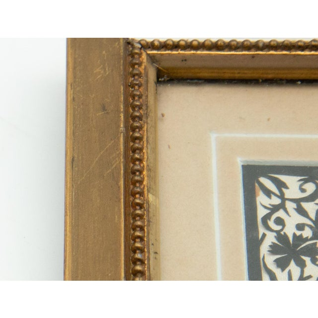 Framed handcut heraldic shield design. Two lions on sides of shield, with intricate floral design in gilded frame....