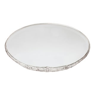 1930s Art Deco Silvered Sculpted Floral Motif Bronze Oval Mirror For Sale