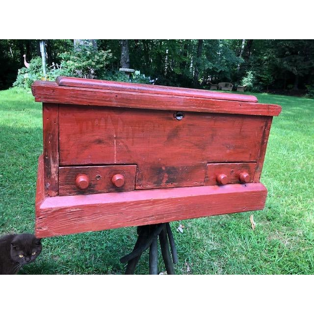 This Primitive/ Americana red painted chest was most likely used for a carpenters tools. Paint looks to be original and is...