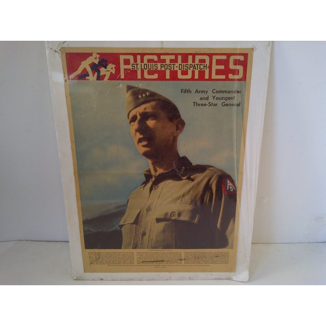 This is a World War II vintage newspaper print featuring Lt. General Mark W. Clark, who was a Fifth Army Commander and the...