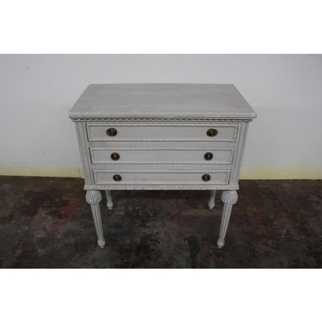 Vintage Gustavian nightstands made of solid oak wood and feature three spacious drawers and elongated legs. Beautiful...