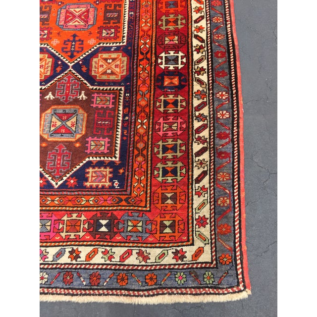 Gorgeous vintage Turkish tribal runner. Runner features vibrant colors with accents of pink throughout. Runner is in...