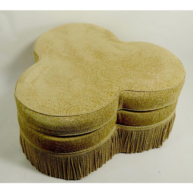 Cloverleaf ottoman with fringed trim by Hickory Furniture Company of North Carolina. Well crafted and stylish, this...