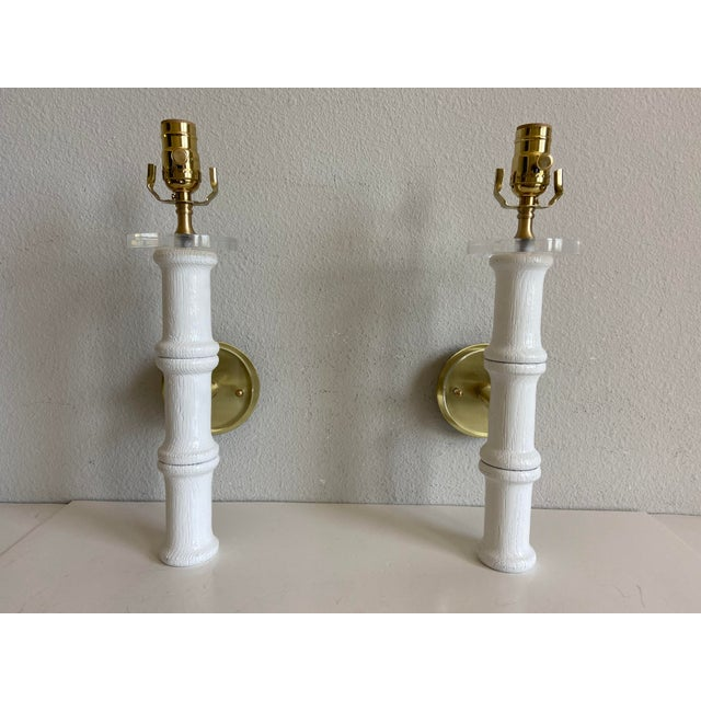 Stunning large pair of 1950s bamboo-style wall sconces of hand-carved oak newly painted white with Lucite tops and new...