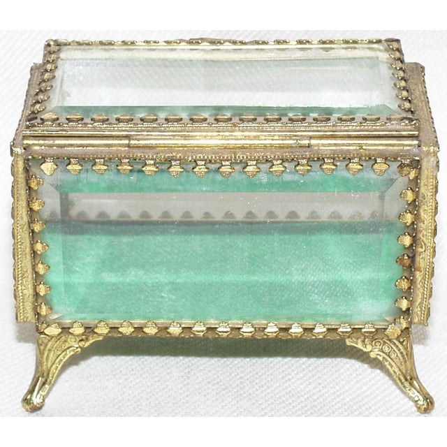 Sweet hand beveled glass jewel or trinket box with brass frame standing on flared legs. French made in the 19th/20th Century.