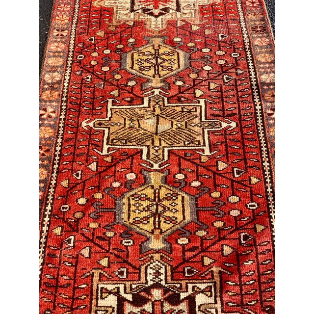 This particular karajeh is hard to find in this length. The look: karajeh rugs have a unique and fun design among Persian...