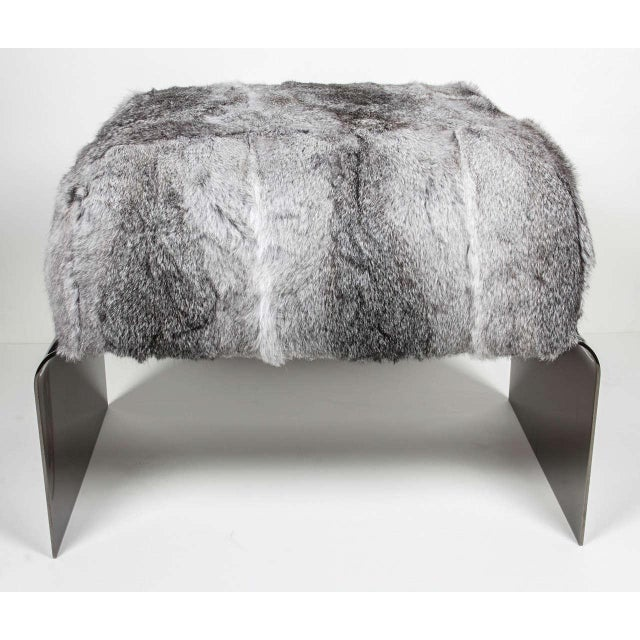 Stunning mid-century modern style stool with streamlined waterfall base design in polished black nickel. The bench is...