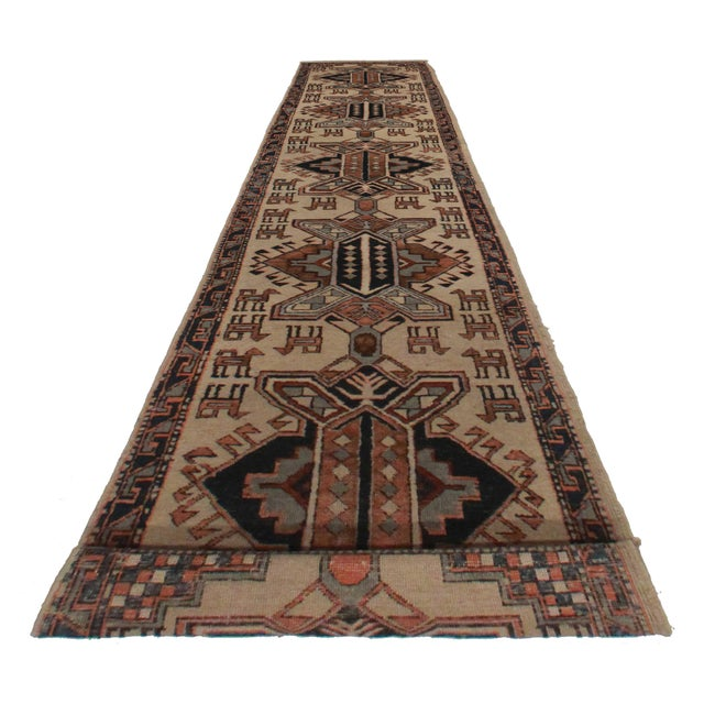 Crafted of hand-knotted wool, this Persian Hamedan runner features an all-over geometric design.