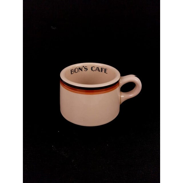The perfect little coffee mug! 1930s Shenango Inca Ware mug with Bon's Cafe on the inside rim. A great little piece of...