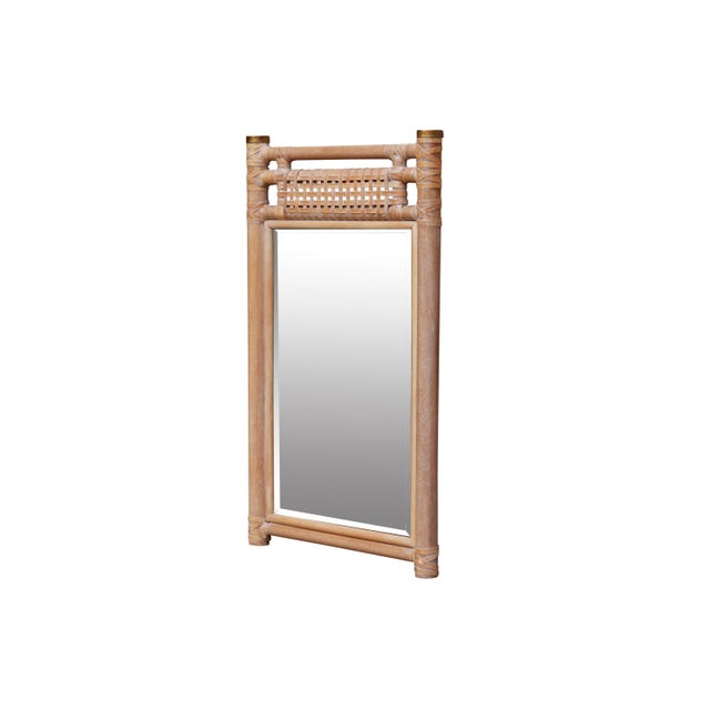 A rectangular beveled wall mirror in a leather bound wooden frame. Rounded oak pieces are decorated with leather wrapping...