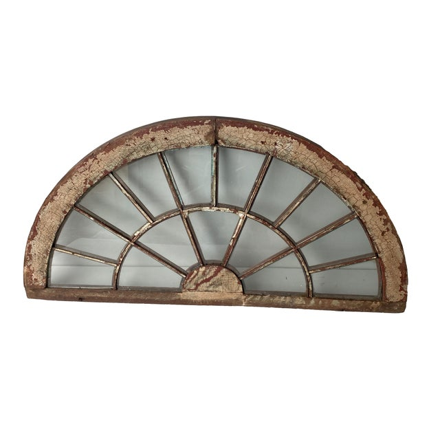 Half round distressed wood window with fifteen panels of glass windows in a sunburst type design. One side is distressed...