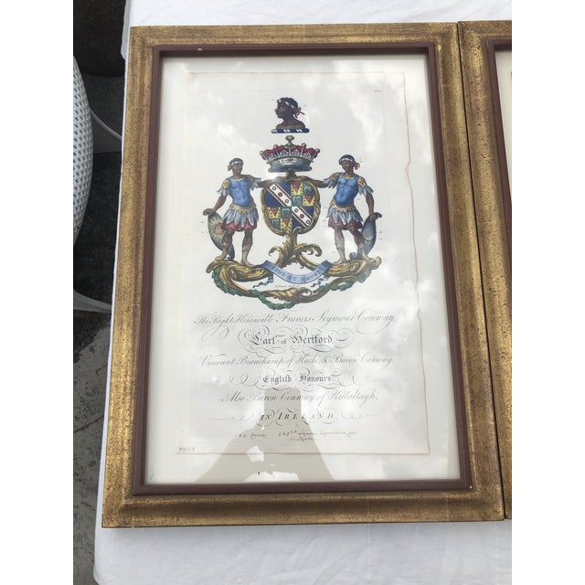 A pair of gilt framed antique engravings, one of the coat of arms of Earl Francis Seymour-Conway, and one of the coat of...