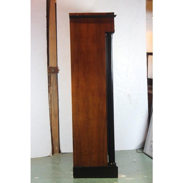 19th century, English. Biedermeier bookcase or china cabinet. Two beautiful ebonized roman column, glass doors, five...