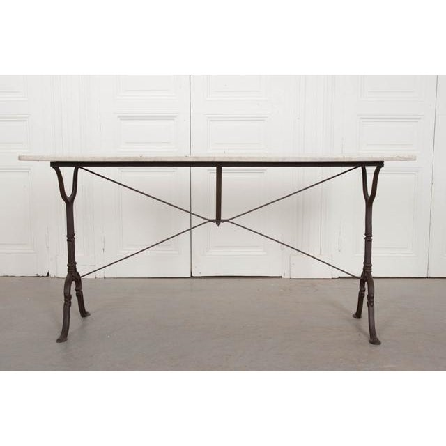 A fabulous cast iron bistro table from early 20th century, France. The long, antique white/gray marble top is in wonderful...