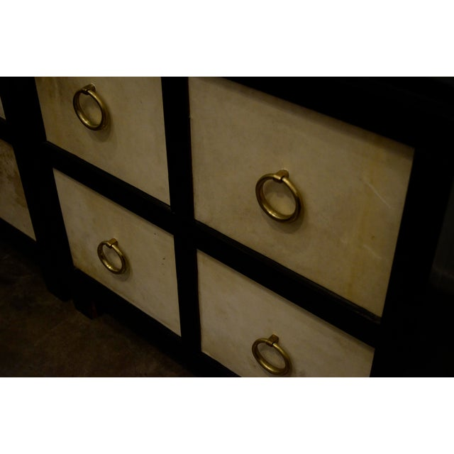 A Pair of French Moderne style Ebonized Wood and Vellum Bedside Cabinets - Image 5 of 7