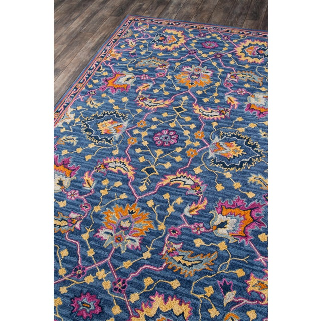 The saturated shades of this decorative area rug reinvent the classic Persian carpet in a vivid color palette. The...