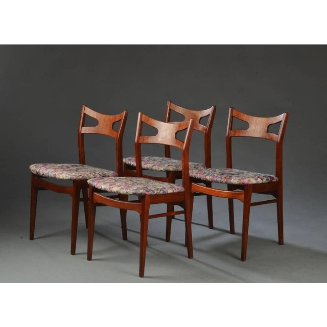 This set of four teak dining chairs was made in Denmark in the 1960s. The design is reminiscent of Hans J. Wegner.