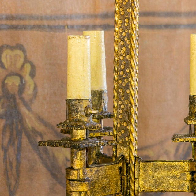 Brutalist gilt-iron floor lamp from the 1940s. This French modern lamp is in a nice, good condition. Hammered forged iron...