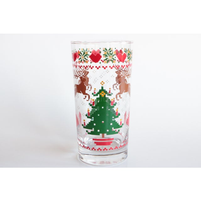 Vintage 1984 highball glassware set featuring a wraparound 8-bit pixelated Christmas scene in crisp, bright traditional...