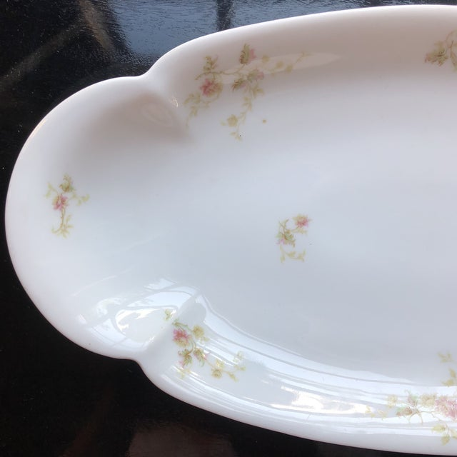 Haviland Limoges pink floral spray long and narrow serving tray. The green Haviland France mark. Dates it to being made...