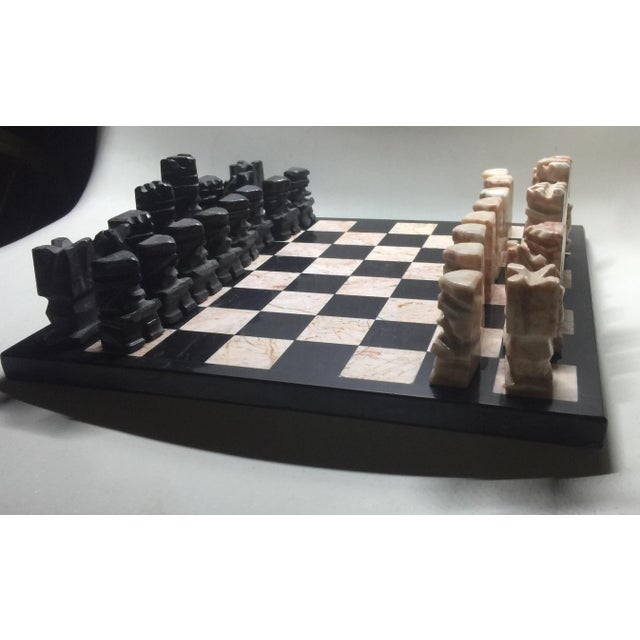 Beautiful hand carved marble Chess set reminiscent of the Aztec Style/motifs. Game board is marble/travertine with no...